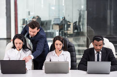 Call center. Business partners are working with their manager in a call center Stock Photo