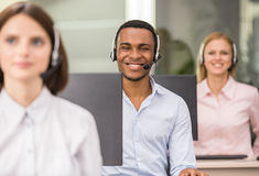 Call center. Call centre agents talking on the headset in the office Royalty Free Stock Photo