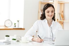 Call Center Concept: Portrait of happy smiling female customer support phone operator at workplace. Call Center Concept: Portrait of happy smiling female Stock Images