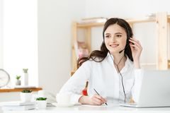 Call Center Concept: Portrait of happy smiling female customer support phone operator at workplace. Call Center Concept: Portrait of happy smiling female Stock Photo