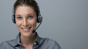 Call center and customer support operator. Smiling beautiful woman with headset: call center and customer support operator stock photo