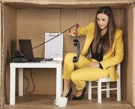 Call center employee cuts the cable from the phone handset, quit Stock Image