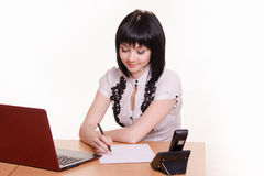 Call-center employee at his desk writes Royalty Free Stock Photo