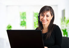Call center employee smiling Royalty Free Stock Photo