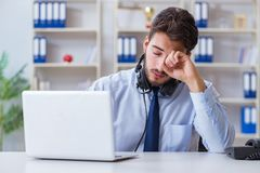 The call center employee working in office Royalty Free Stock Photos