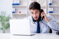 The call center employee working in office Royalty Free Stock Images