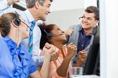 Call Center Employees Celebrating Success Stock Photo
