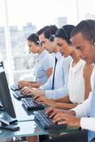 Call center employees sitting in line Royalty Free Stock Photos