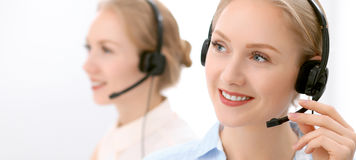 Call center. Focus on beautiful blonde woman in headset Royalty Free Stock Photo