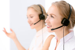 Call center. Focus on beautiful blonde woman in headset Stock Images