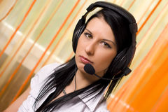 Call center girl with headphones Royalty Free Stock Image