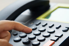 Call center Hand dialing telephone stock images