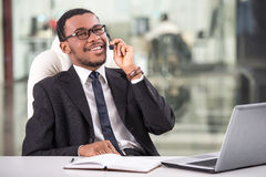 Call center. Handsome young businessman is taking a call on a headset as he deals with queries at the customer support call centre royalty free stock image