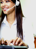 Call center information. Latin operator with headset, working at the office Stock Photos