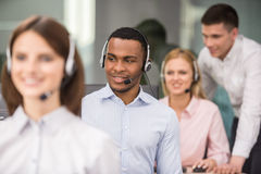 Call center. Manager explaining something to his employee in a call centre Stock Images