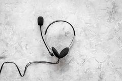 Call center manager`s accessories. Headphones on gery background top view copyspace Royalty Free Stock Images