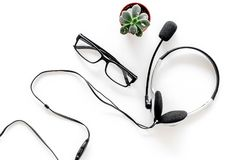 Call center manager`s accessories. Headphones on white background top view Stock Image