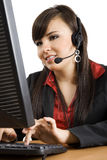Call Center operator. Stock image of female call center operator over white background Royalty Free Stock Image
