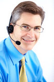 Call Center Operator. Smiling businessman with headset. Over white background royalty free stock images