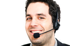 Call center operator. Handsome smiling young man wearing an headset Stock Photos