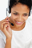 Call center operator. On telephone smiling Royalty Free Stock Image