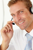 Call center operator. Smiling at camera Royalty Free Stock Photo