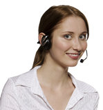 Call center operator. With headset, isolated on white background Stock Photography