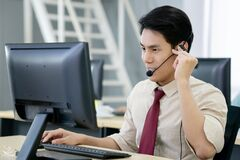 Call Center Operator Agent In A Headset With Microphone Consulting Client Online Close Up, Focus On The Face Royalty Free Stock Photography
