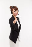 Call center operator business woman show thumb. Royalty Free Stock Images
