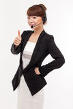 Call center operator business woman show thumb. Royalty Free Stock Image