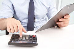 Call center operator counting on calculator Royalty Free Stock Photos