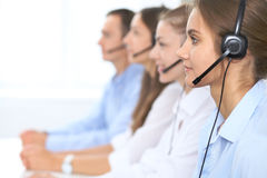 Call center operator in headset while consulting client. Telemarketing or phone sales. Customer service and business. Concept Stock Images