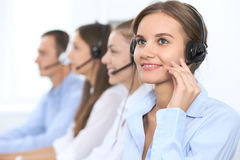 Call center operator in headset while consulting client. Telemarketing or phone sales. Customer service and business. Concept Royalty Free Stock Photos