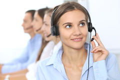 Call center operator in headset while consulting client. Telemarketing or phone sales. Customer service and business. Concept Stock Photos