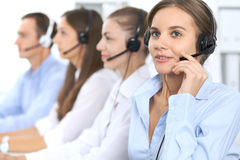 Call center operator in headset while consulting client. Telemarketing or phone sales. Customer service and business Stock Photography
