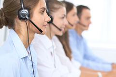 Call center operator in headset while consulting client. Telemarketing or phone sales. Customer service and business. Concept Stock Photo