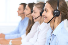 Call center operator in headset while consulting client. Telemarketing or phone sales. Customer service and business. Concept Royalty Free Stock Photo
