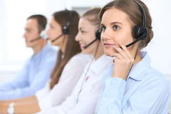 Call center operator in headset while consulting client. Telemarketing or phone sales. Customer service and business Royalty Free Stock Image