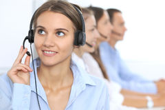Call center operator in headset while consulting client. Telemarketing or phone sales. Customer service and business. Concept Royalty Free Stock Image