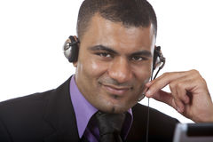 Call center operator with headset is happy Royalty Free Stock Image
