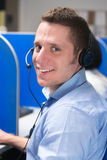 Call center operator with headset smiling. Customer service representative with headset in office Stock Images