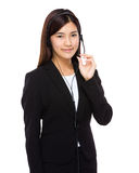 Call center operator hold with microphone Royalty Free Stock Image