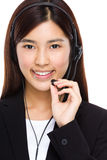 Call center operator hold with microphone Royalty Free Stock Photos