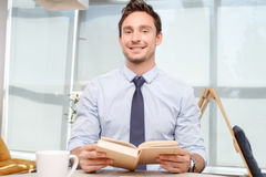 Call center operator holding book Stock Photography