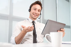 Call center operator holding laptop Stock Images