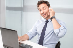 Call center operator holding mobile phone Stock Photography