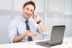 Call center operator holding mobile phone Stock Photo