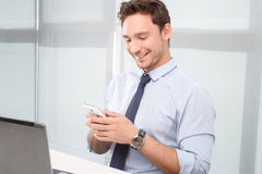 Call center operator holding mobile phone Stock Images