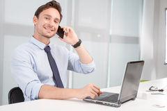 Call center operator holding mobile phone Royalty Free Stock Image