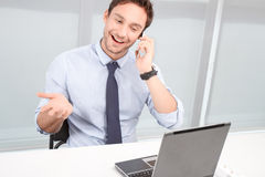 Call center operator holding mobile phone Royalty Free Stock Photos